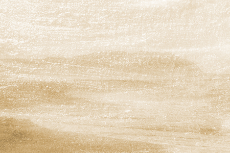Shimmery gold paint textured background Stock Photo