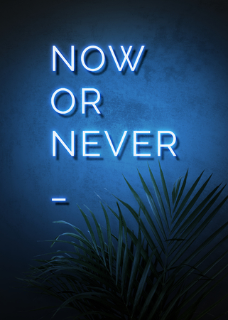 Neon blue now or never sign on a wall