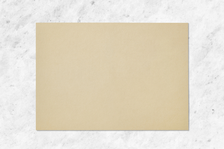 Brown paper on a marble background Stock Photo