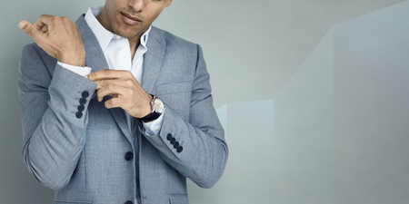 Businessman buttoning his shirt sleeve