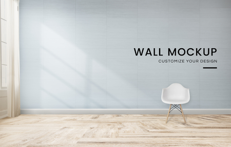 White chair against a blue wall mockup