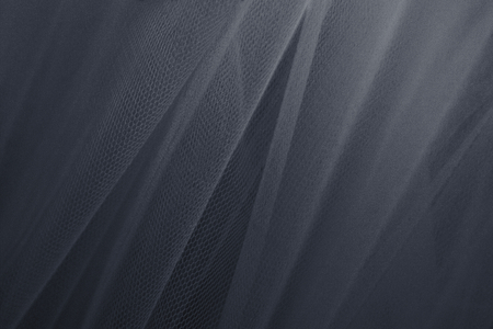 Gray tulle drapery textured background