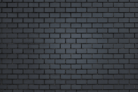 Dark gray brick wall textured background