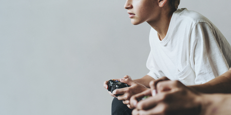 Young man playing a video game