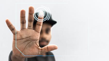 Black man scanning his finger Banco de Imagens
