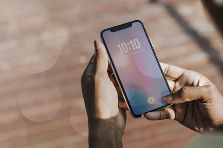 Woman checking time from her phone