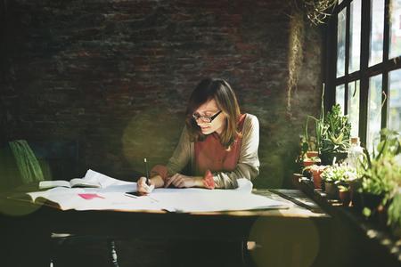 Female architecture drawing on a plan layout Reklamní fotografie