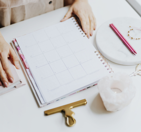 Woman with her daily planner Stockfoto