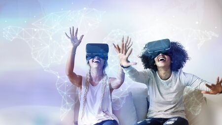 Happy friends trying on VR headsets