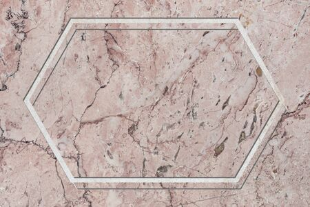 Hexagon frame on pink marble textured background