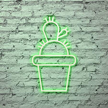 Neon green cactus on a brick wall