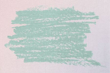 Mint green oil paint brush stroke texture on a pink fabric textured background