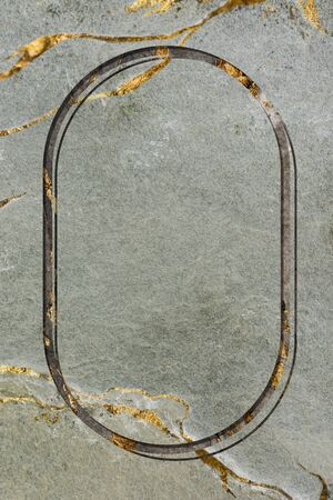 Oval frame on green marble background