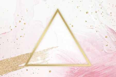 Gold triangle frame on a pink background 写真素材