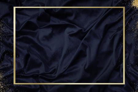 Gold frame on a silky navy blue fabric textured background illustration Standard-Bild