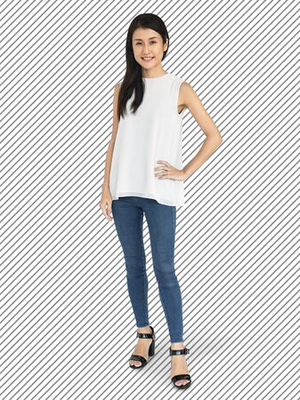 Cheerful Asian woman in jeans character isolated on a striped background 写真素材