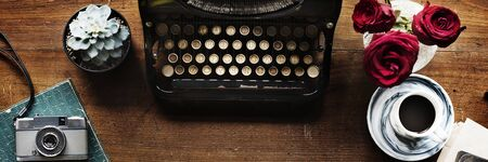 Retro typewriter on a wooden table website banner template Фото со стока