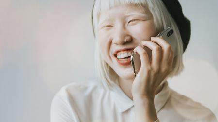 Albino girl talking on her phone