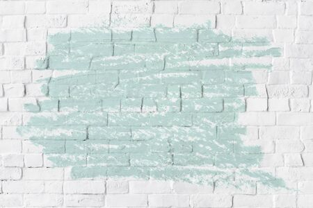 Mint green oil paint texture on a white brick wall Archivio Fotografico - 125485808