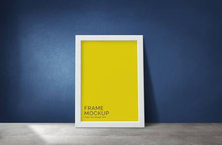Maquette de cadre contre un mur bleu