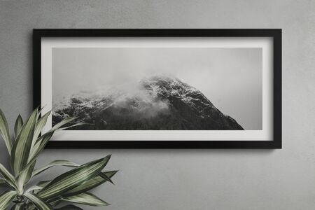Black frame mockup on a black wall
