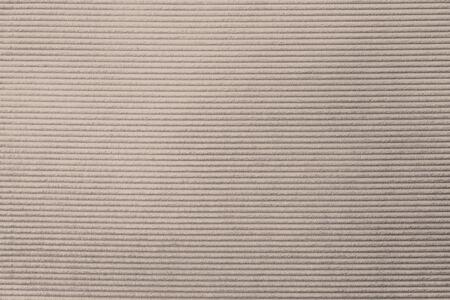 Beige corduroy fabric textured background
