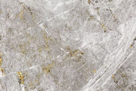 Gray and gold marble textured background