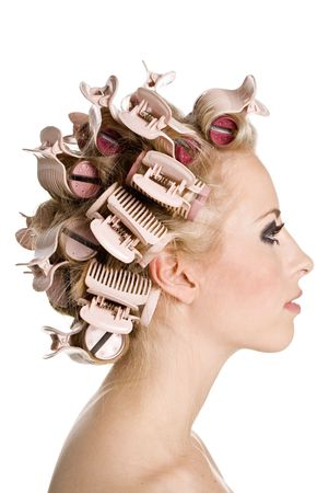 Young beautiful girl is having hair curlers on her head Stock Photo - 3459634