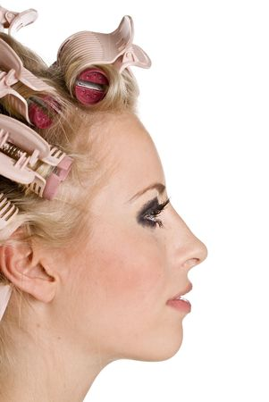 Young beautiful girl is having hair curlers on her head Stock Photo - 3595346
