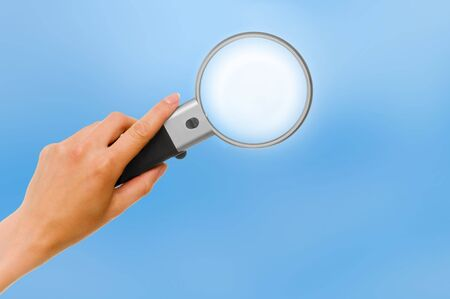 woman handle success: magnifying glass Stock Photo