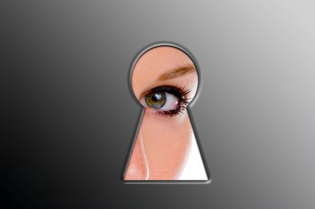 Woman looks through a keyhole Stock Photo
