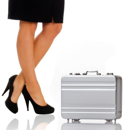Beautiful legs of the business woman with briefcase photo