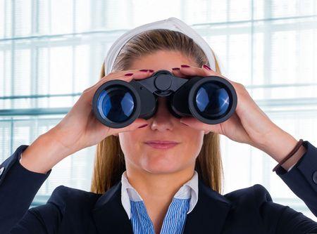 woman watching through binocular Stock Photo - 6723367