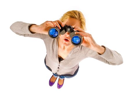 close up of woman watching through binocular photo