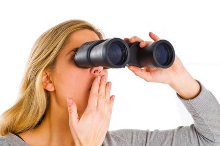 close up of woman watching through binocular photo