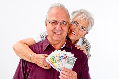 senoir couple is happy about a lot of money Stock Photo