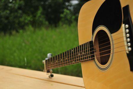 Close-Up Of Park Bench Guitar photo
