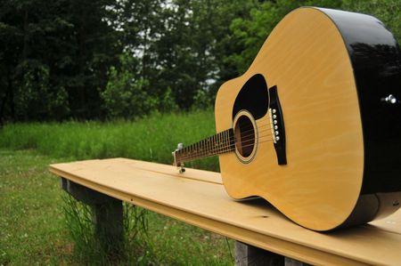 Guitar Resting On Bench Stock fotó