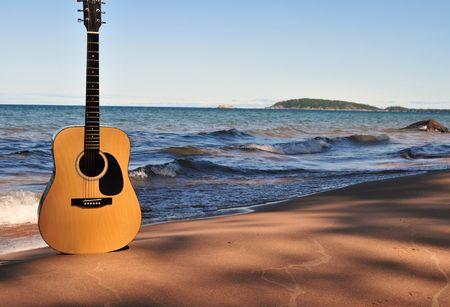 海岸のギター 写真素材