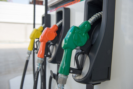 energize: Colorful fuel oil gasoline dispenser at petrol filling station Stock Photo