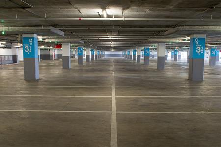 Parking garage underground interior, neon lights in dark industrial building, modern public construction photo