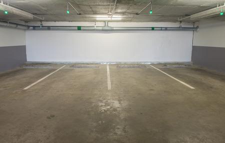 multi story car park: Parking garage underground interior, neon lights in dark industrial building, modern public construction