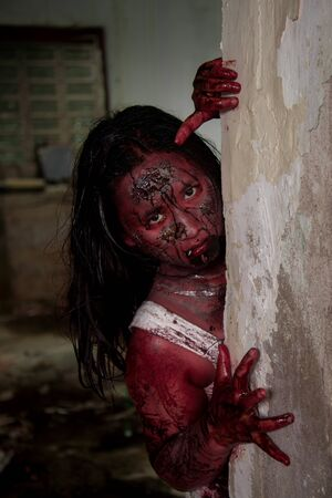 demonic: Zombie girl in haunted house scary