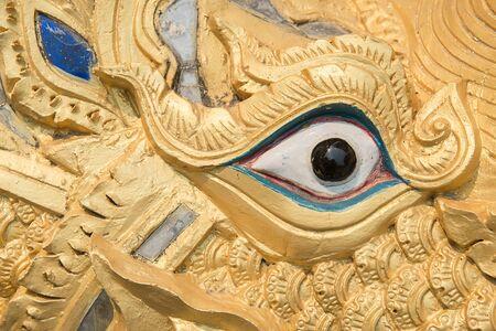 himmapan: Mombasa eatingnaga statue in temple Chiangmai Thailand. Stock Photo