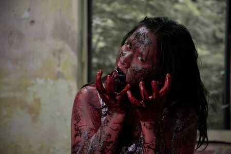 terrific: Zombie girl in haunted house scary