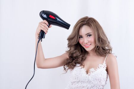 hairdryer: portrait of beautiful young woman with fashion hairstyle holding hairdryer,Woman with hairdryer