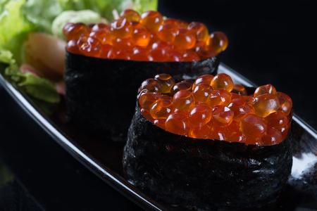 japanese cuisine: Ikura sushi , ikura with seaweed (Nori), japanese cuisine,Salmon roe Stock Photo