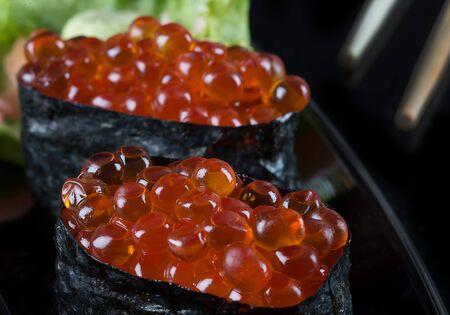 nori: Ikura sushi , ikura with seaweed Nori, japanese cuisine,Salmon roe