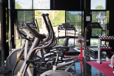 crosstrainer: Exercise machines in a fitness club Stock Photo