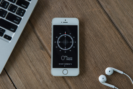 5s: CHIANGMAI, THAILAND -JUNE 22, 2015:Apple iphone 5s displaying Compass application. Editorial